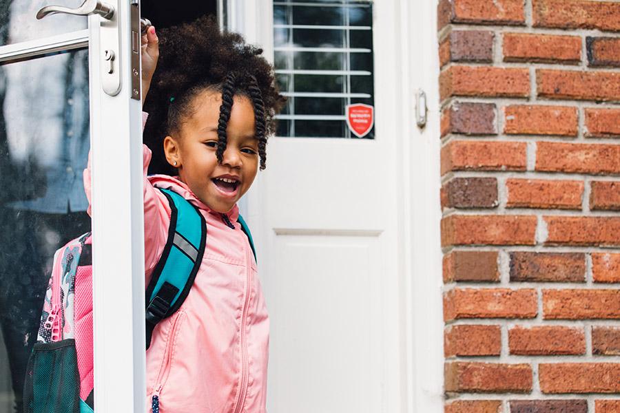 Girl in doorway at school