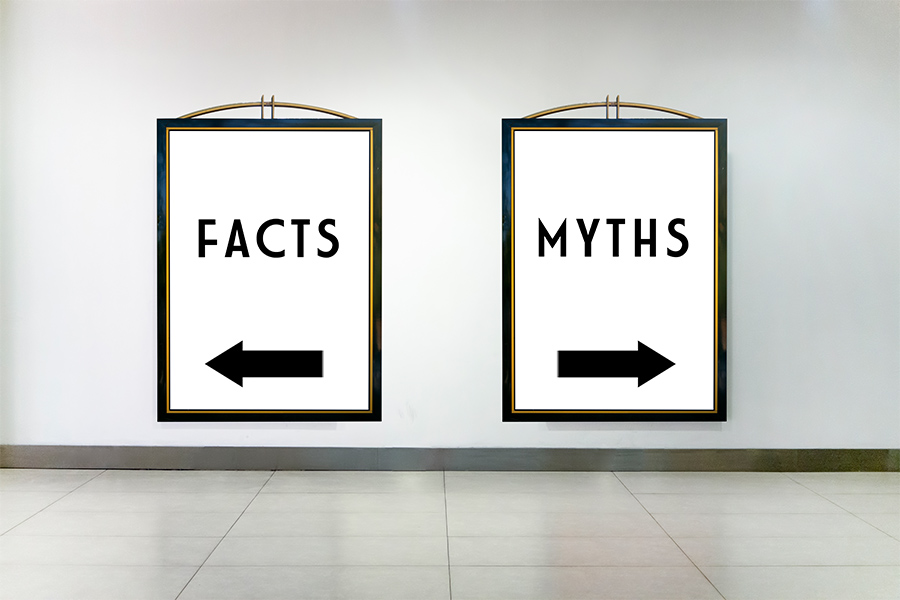 Signs that say Facts and Myths pointing in opposite directions